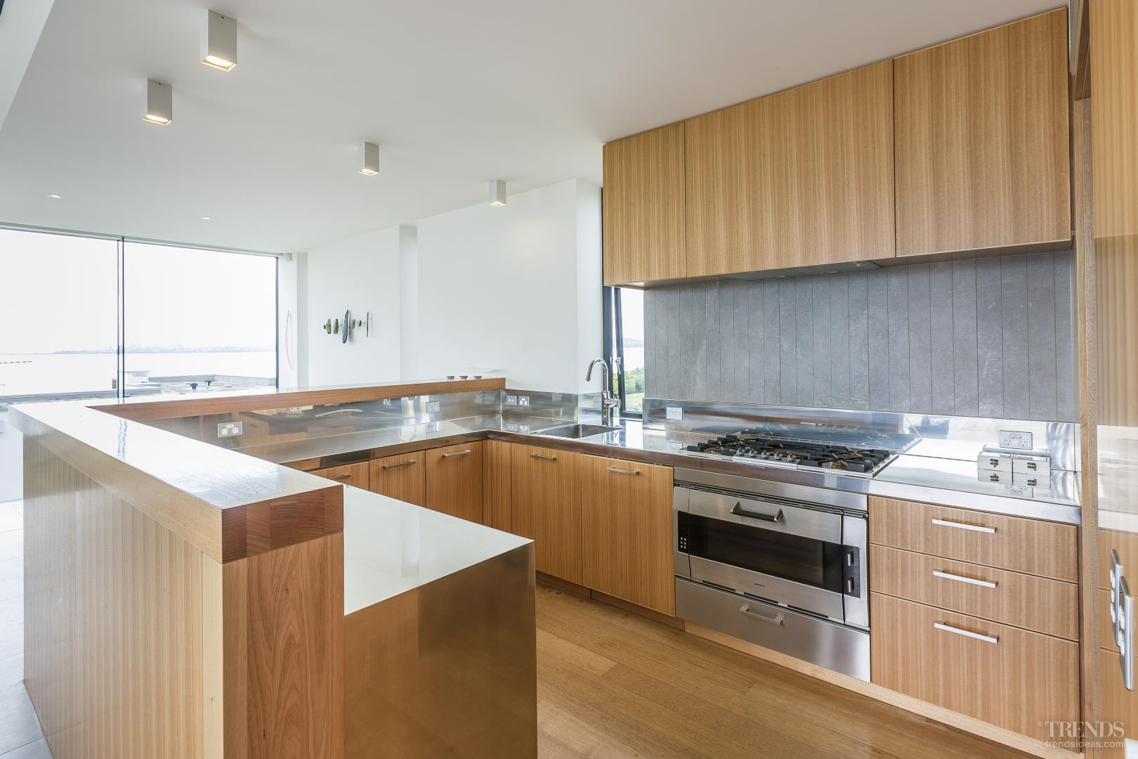 Sleek modern kitchen with tasmanian oak veneer and for Contemporary oak kitchen cabinets