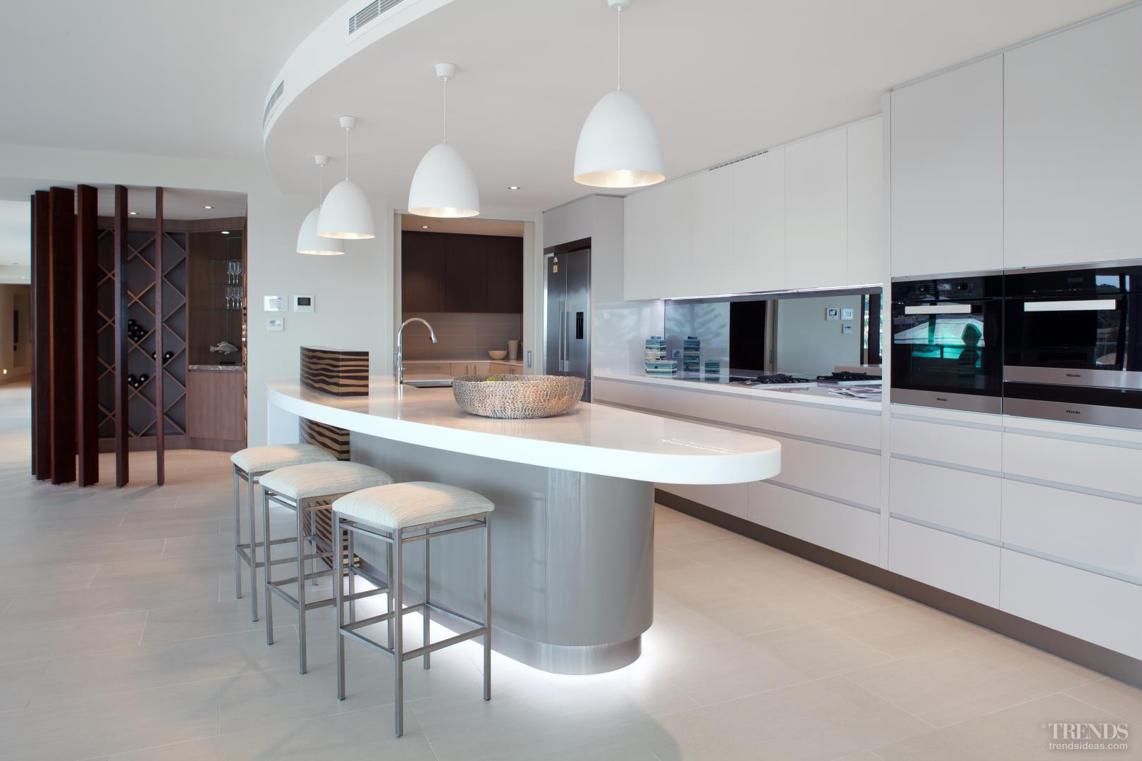 New penthouse kitchen with curved island and wood veneer - The penthouse apartment in kiev when nature meets modern ...