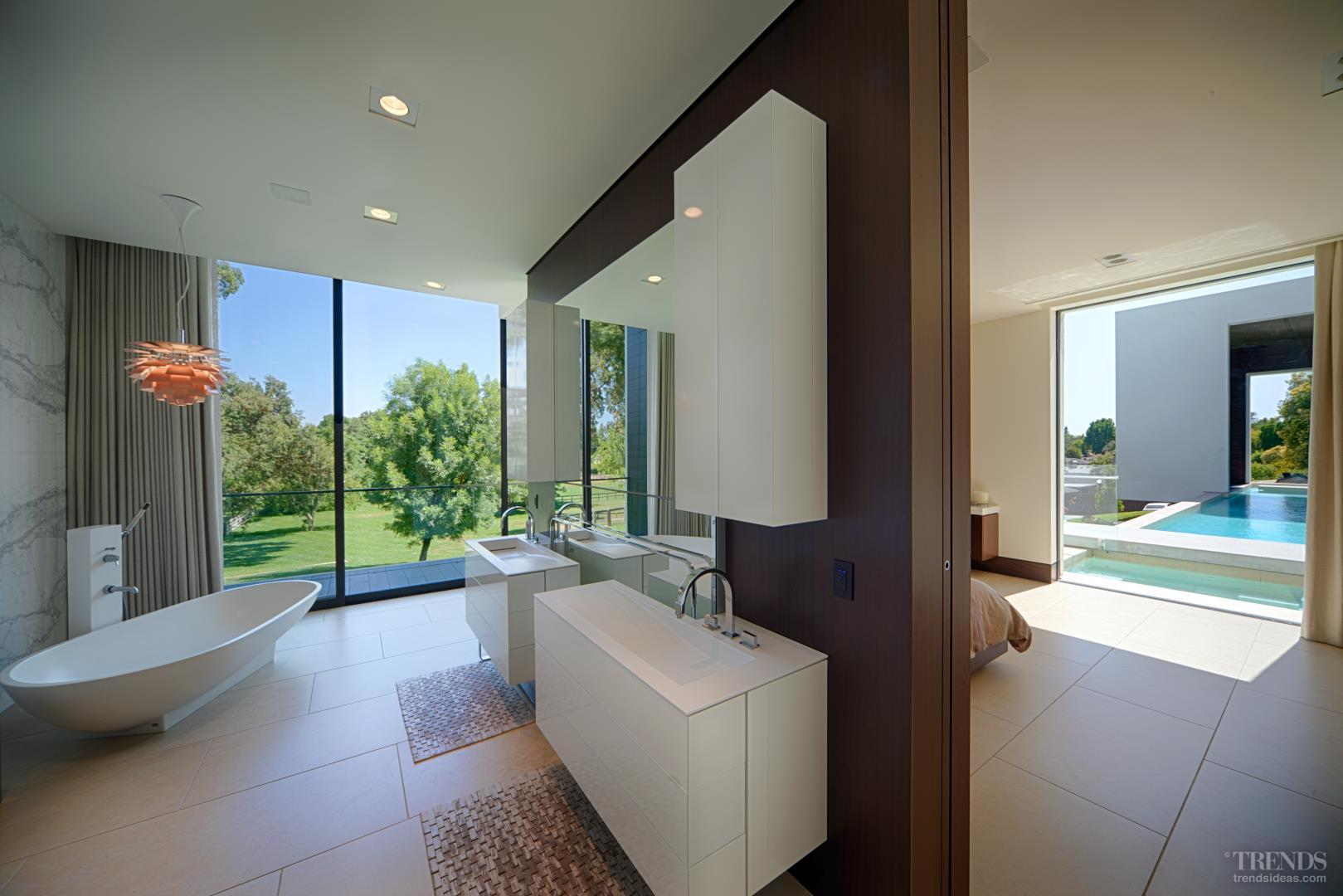 Open Plan Master Suite With Freestanding Bathtub Sapele Wood Wall Pocket Doors