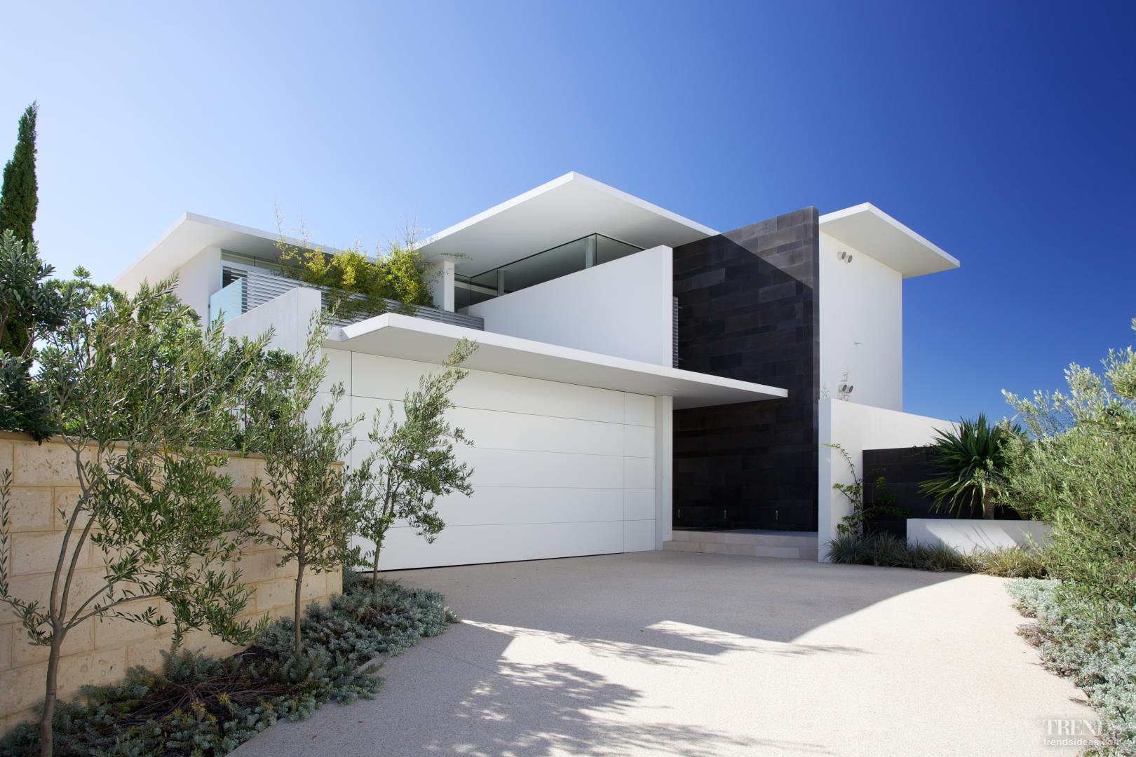 Coastal Home With Large Roof Overhangs And Protected