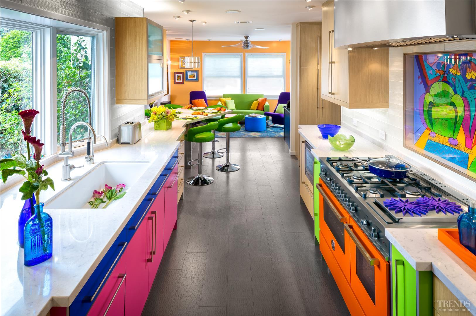 colorful kitchen with orange range mixes colored cabinets