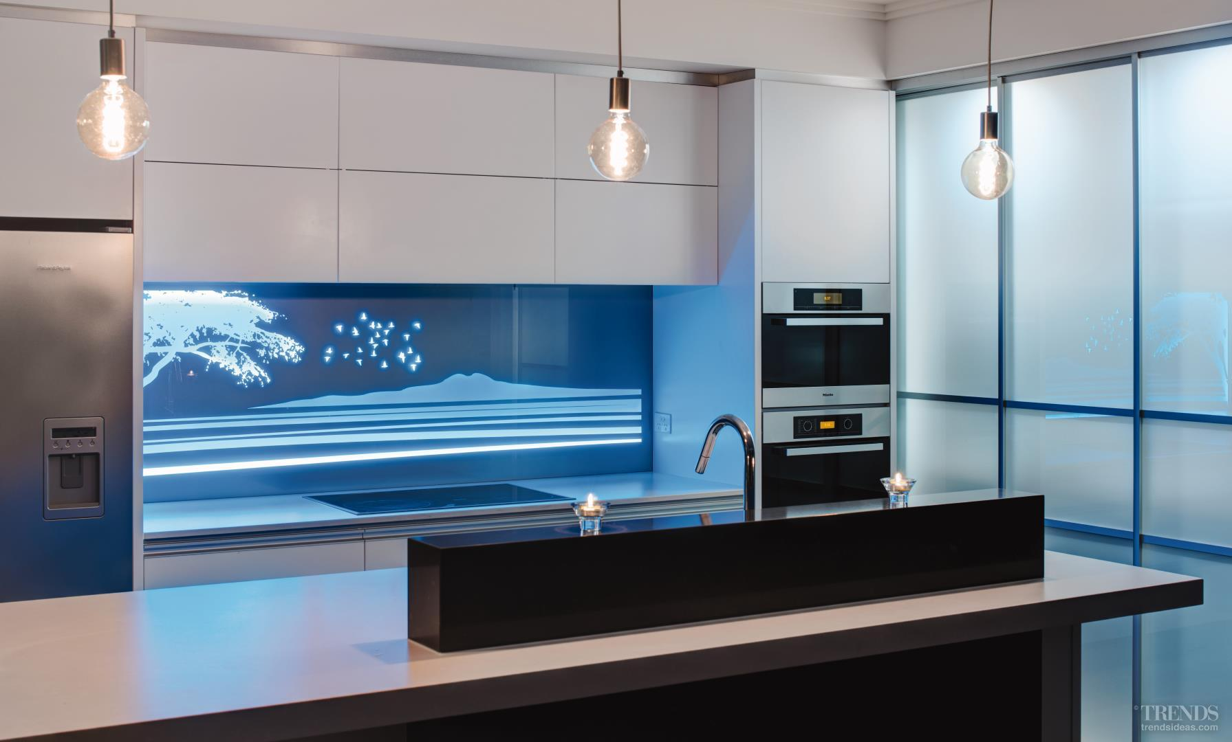 High end illuminati backlit glass panels can transform a - Glass wall panels kitchen ...
