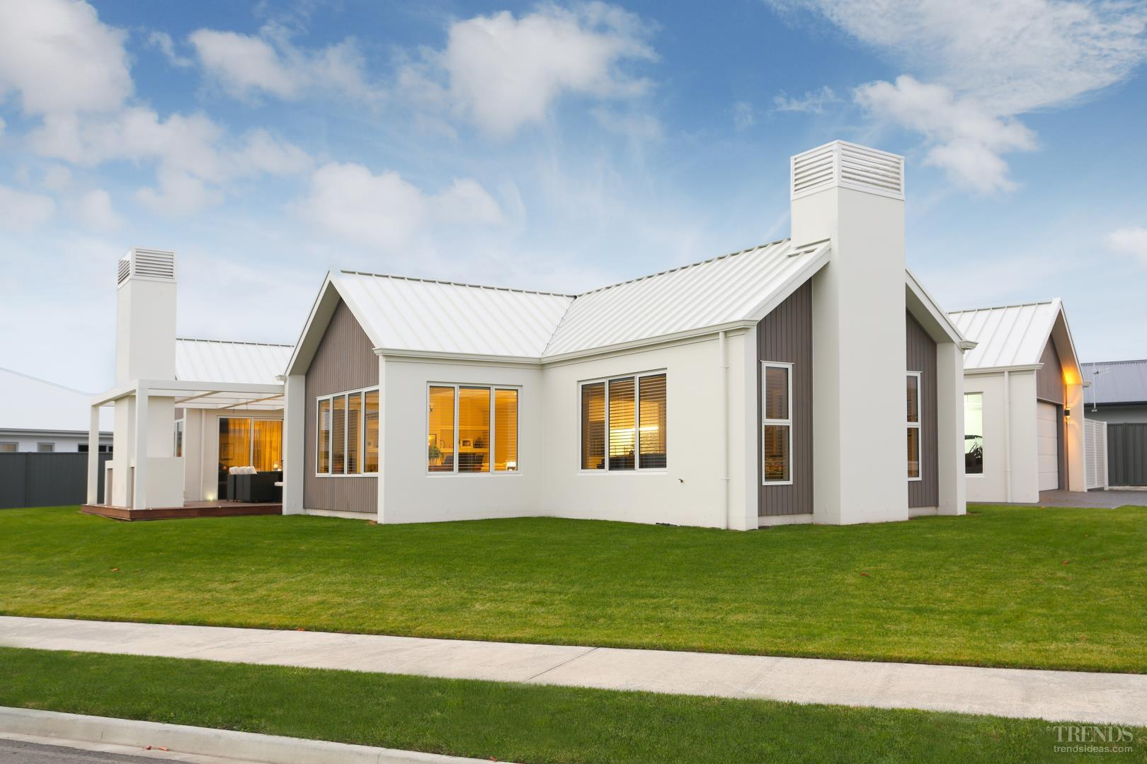pavilion style house with four end gables has plenty of