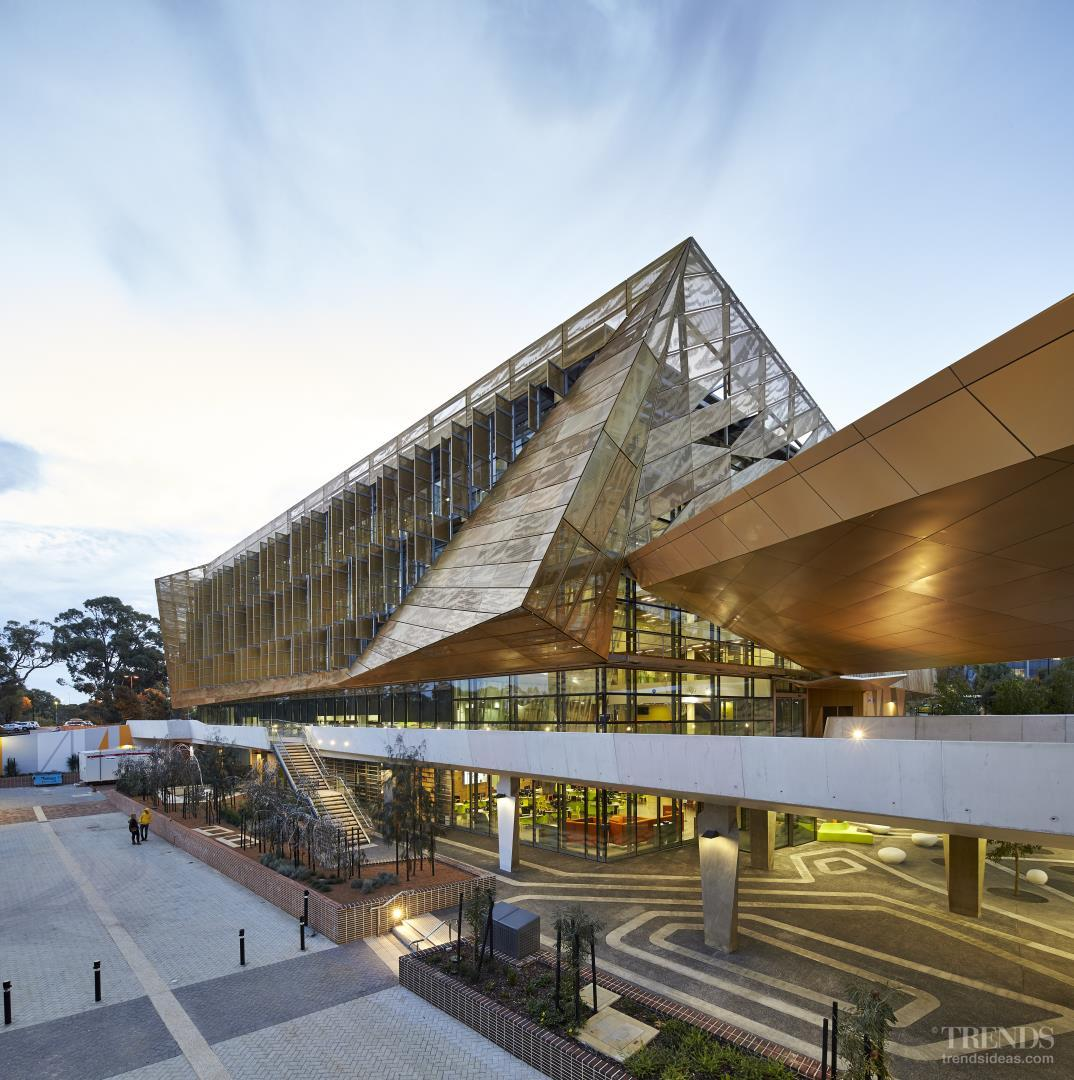 Modern university campus with student building in gold perforated aluminium veil