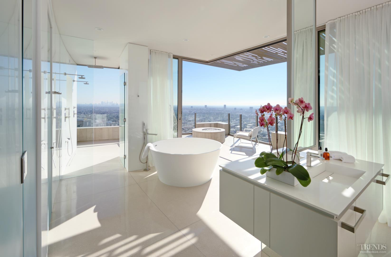 White bathroom with stone floor, minimalist design and dramatic outlooks
