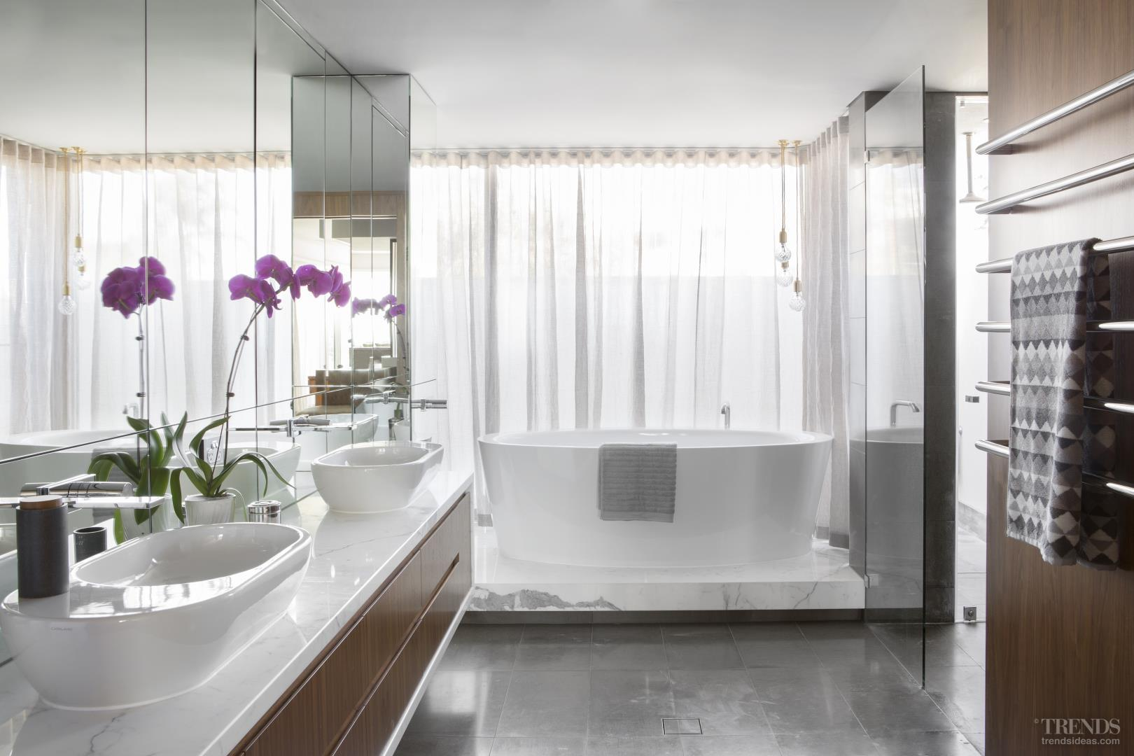 Upmarket bathroom suite with natural materials and freestanding tub