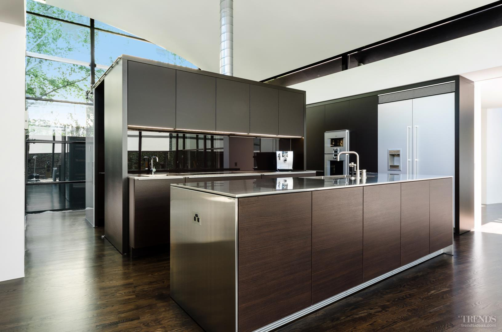 Cube Shaped Kitchen Combines Two Tone Poggenpohl Cabinetry With Stainless Steel Benchtops