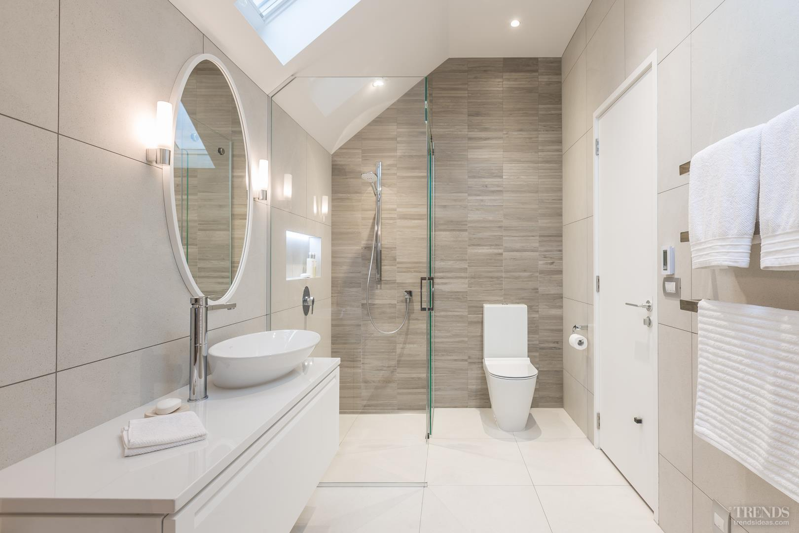White bathroom with angular ceiling and timber-look tiles