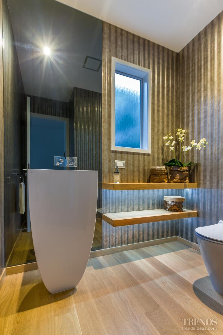 Corrugated iron-look wallpaper provides backdrop for powder room