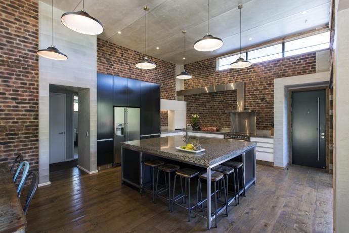 Semi-industrial materials define this kitchen