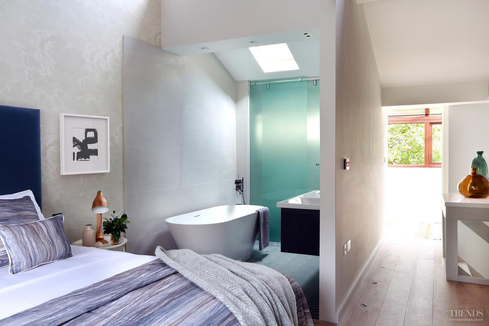 Contemporary renovation with open-plan bathroom and bedroom
