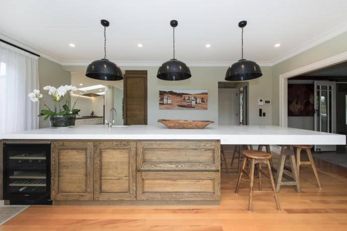 This Arts & Crafts-style entertainer's kitchen is backed by a large fully functional scullery