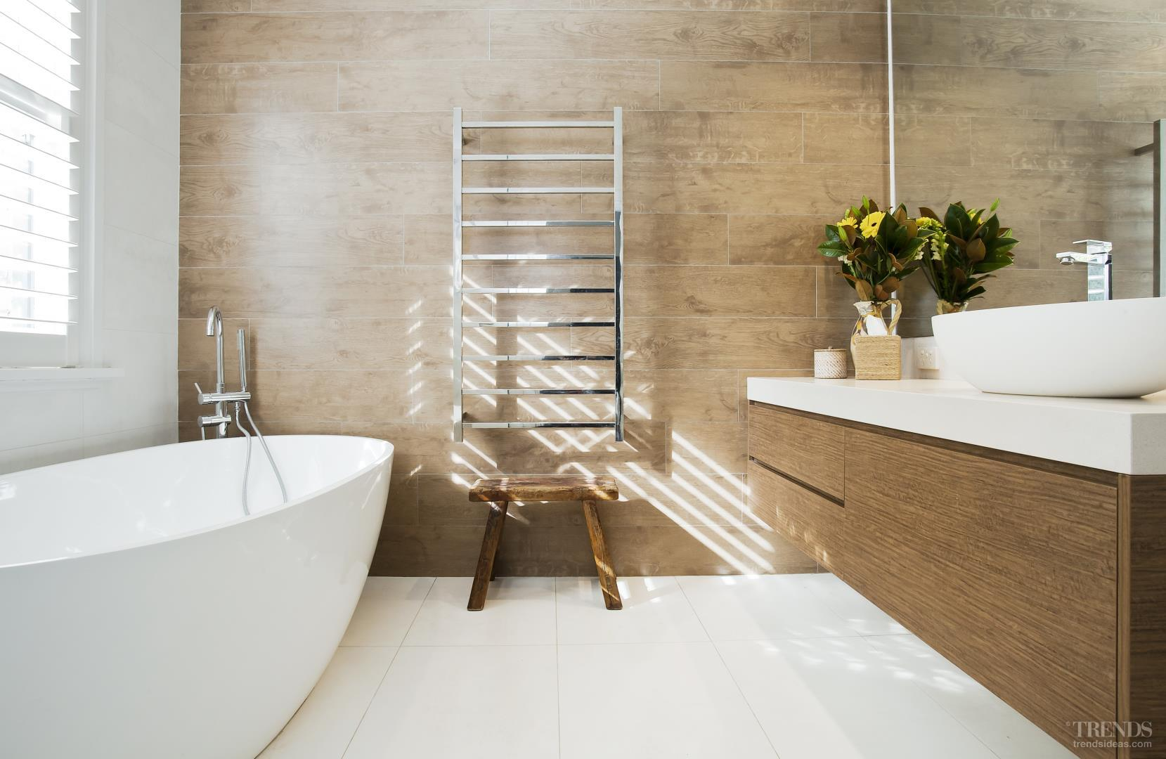 contemporary bathroom addition has timberlook tile