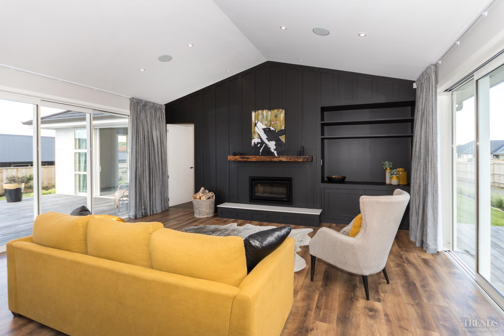 an inky black feature wall adds a dramatic touch to the ligh