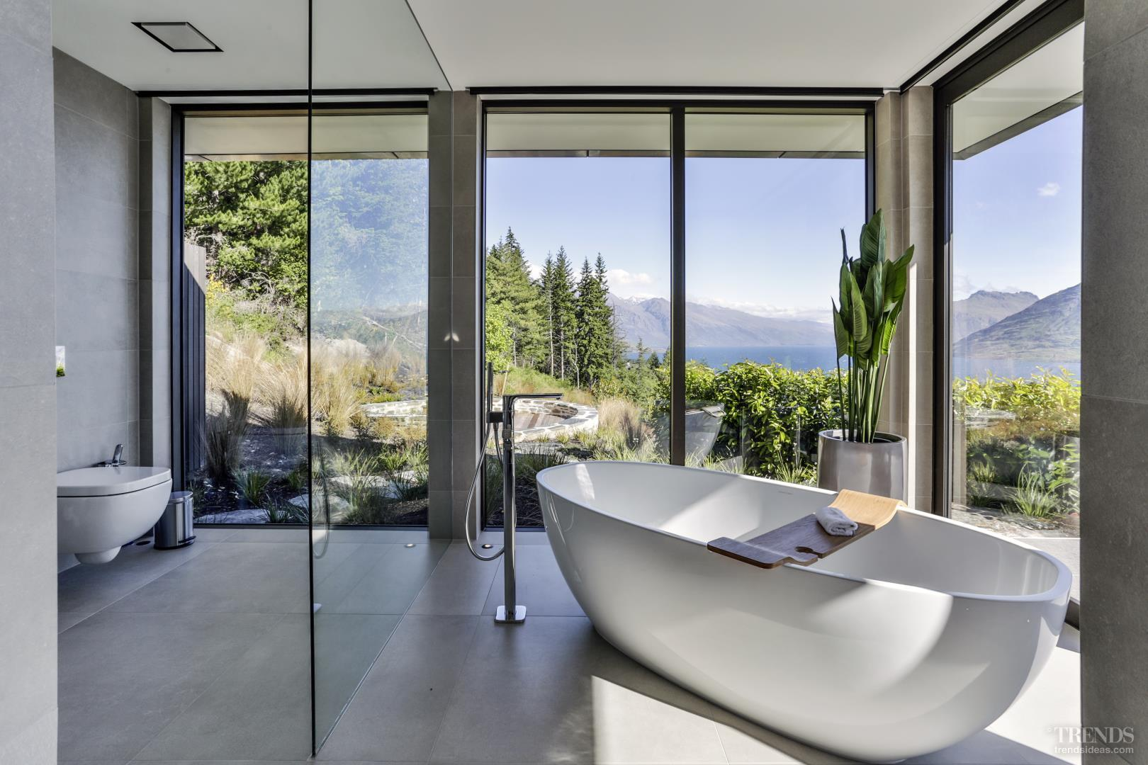 Large Window Walls In Master Ensuite Make The Most Of
