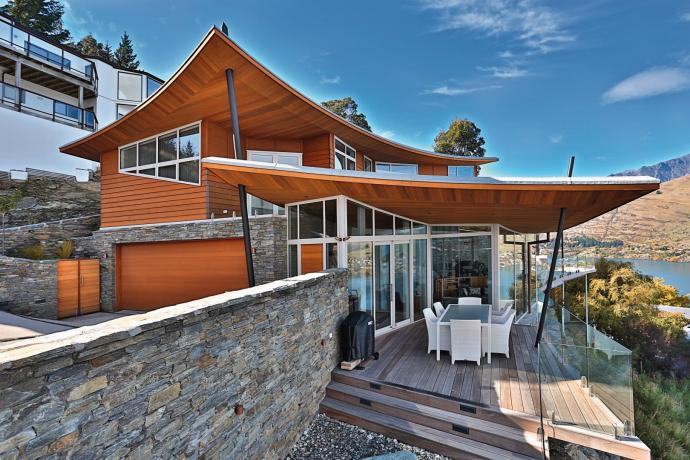 Sweeping roofline required advanced window systems to make the most of lake views