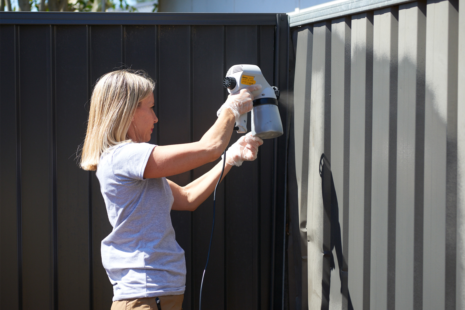 Cherie-Barber_Renovating-For-Profit_Backyard-Makeover-Paint-Fence