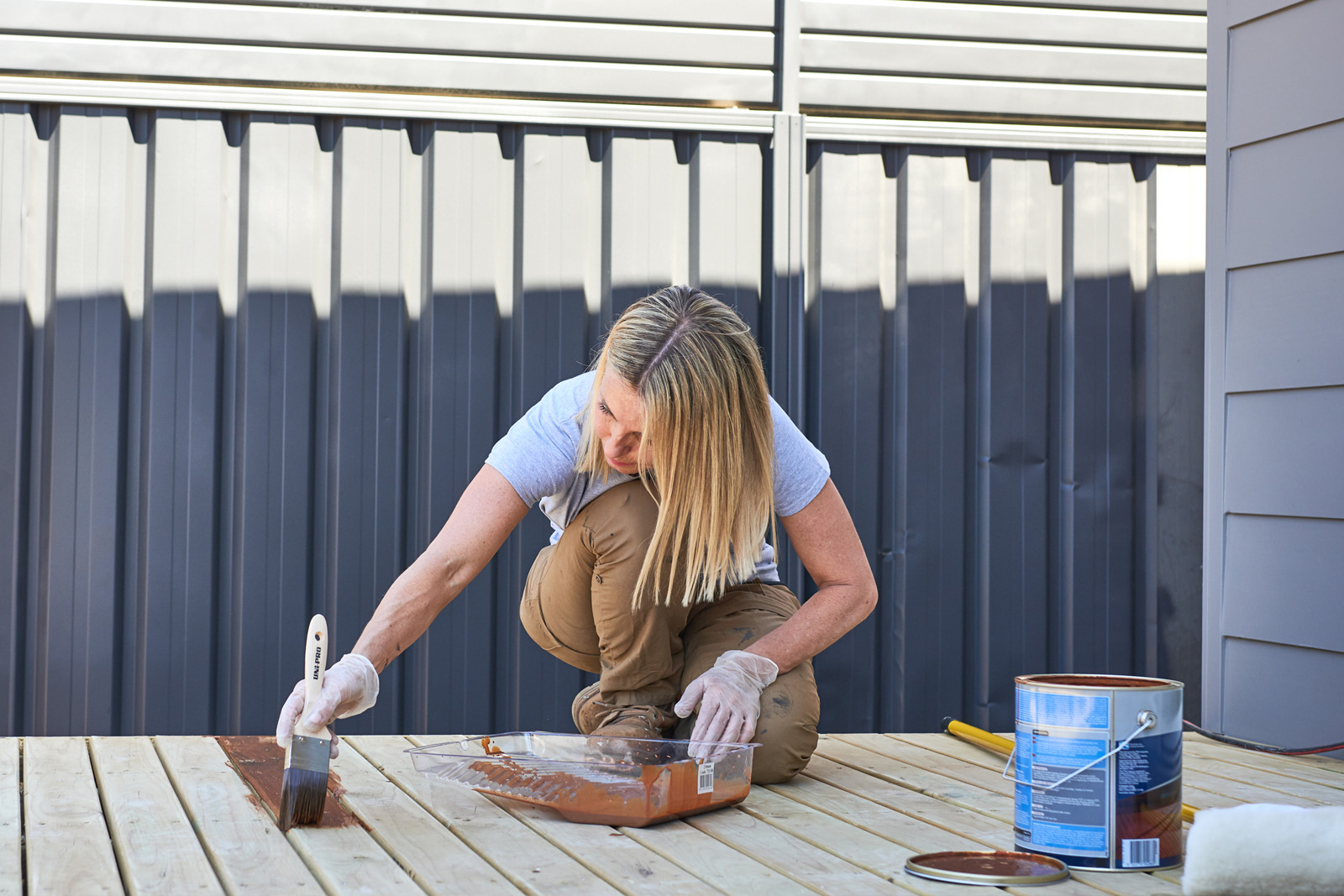 Cherie-Barber_Renovating-For-Profit_Backyard-Makeover-Paint-Deck