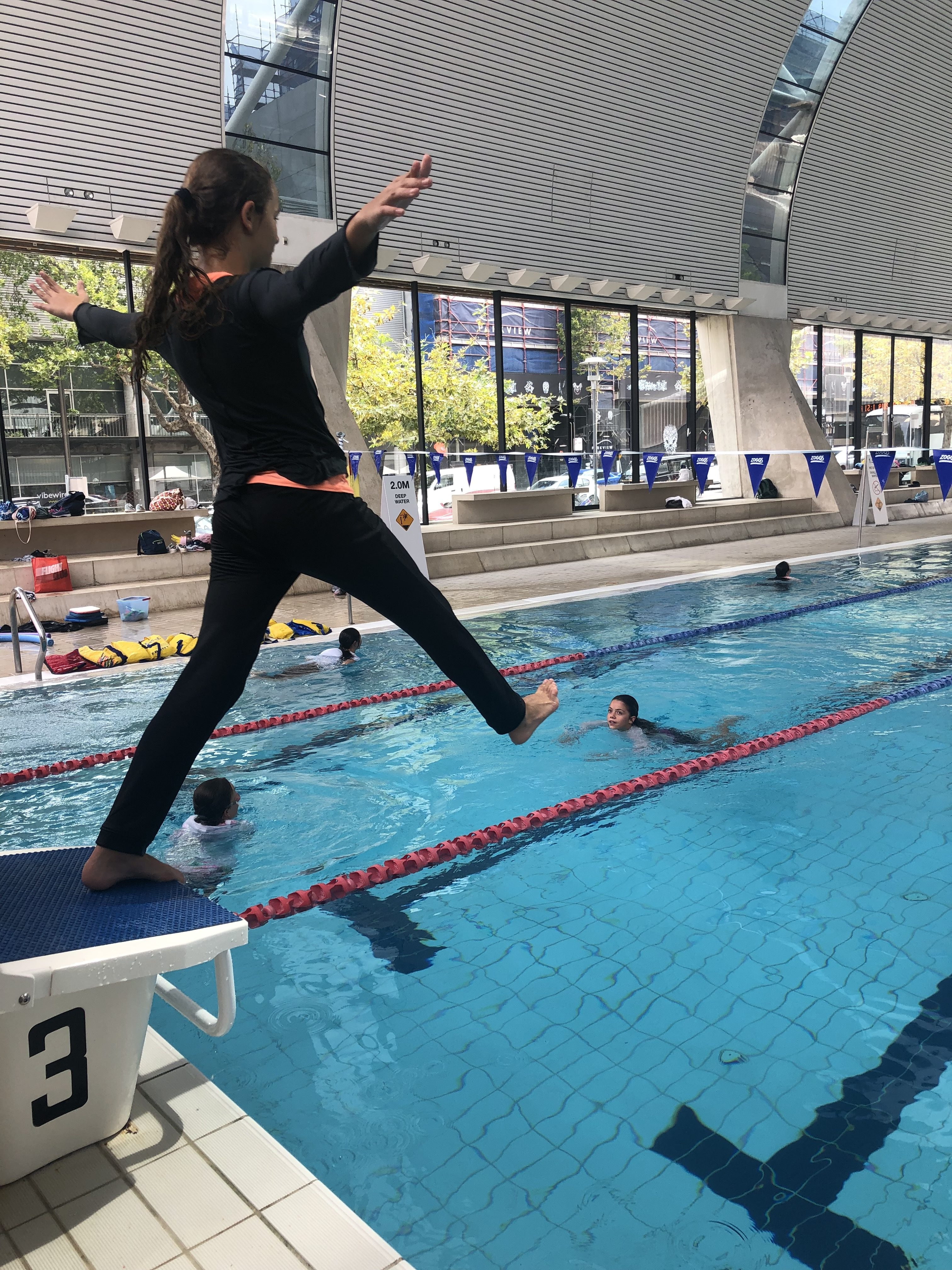 igs-water-safety-skills-group-in-pool-activities-jump