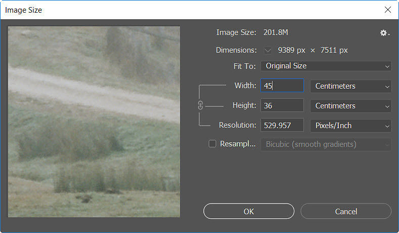 Set the desired printed image size via the 'image size' dialogue in the 'image' menu - be sure to keep the 'resampling' box unchecked.