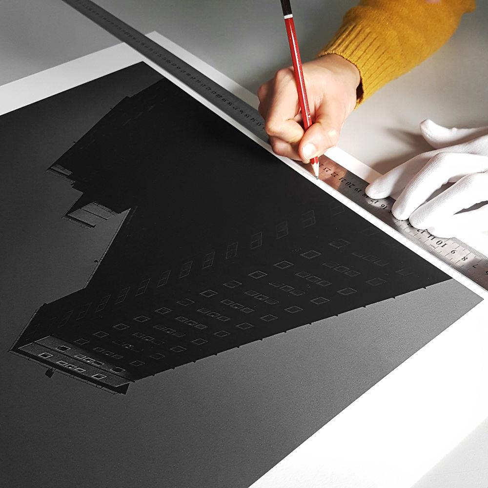 Editioning a digital print by hand.