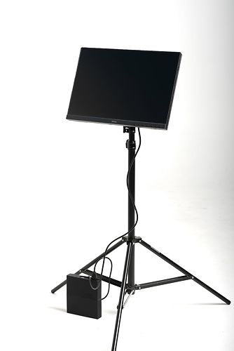 Battery in use with tripod mounted monitor