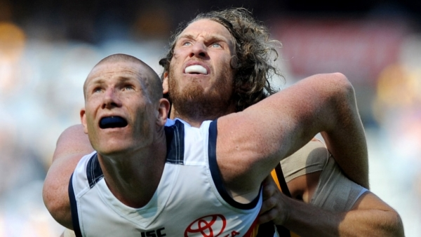 AFL leaders Adelaide wary of wounded Hawks