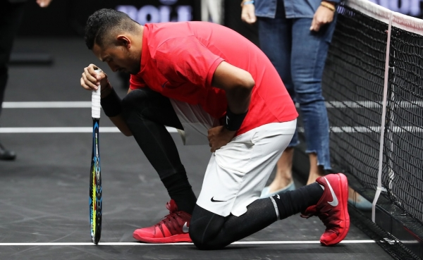 Nick Kyrgios denies taking knee before Roger Federer match was protest against Donald Trump