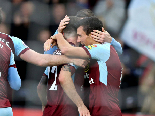 Jack Cork comes back to haunt former club Swansea as Burnley heap yet more pressure on Paul Clement