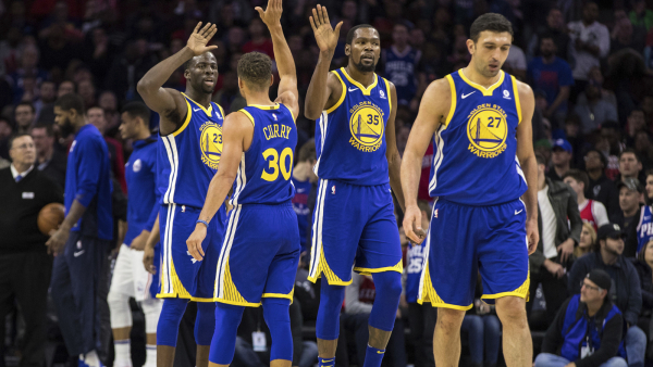 Curry scores 35, Warriors rally to beat 76ers 124-116