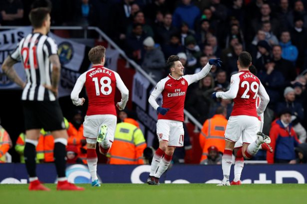 "Arsene Wenger insists he is ""confident"" Mesut Ozil will remain at Arsenal after stunning winner vs Newcastle"
