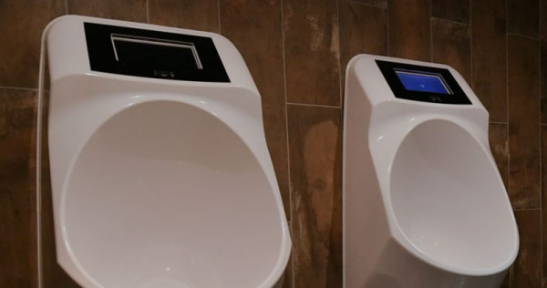 Dutch toilet startup built a smart urinal that serves ads while you pee