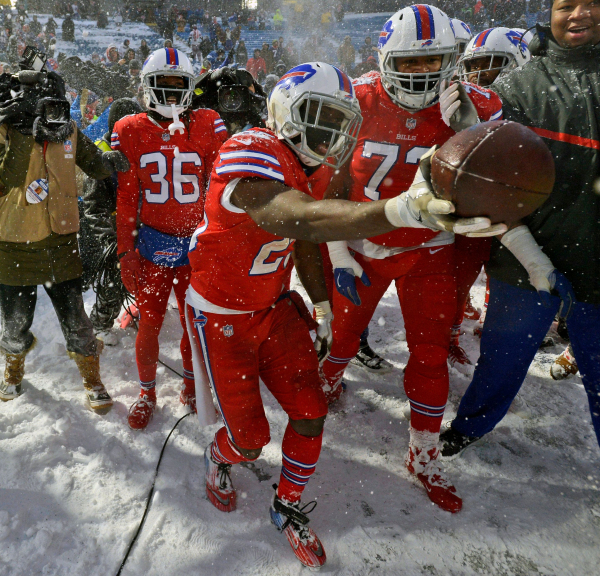 McCoy slides through snow to lift Bills past Colts 13-7