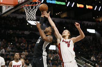 Aldridge helps balanced Spurs top Heat 117-105