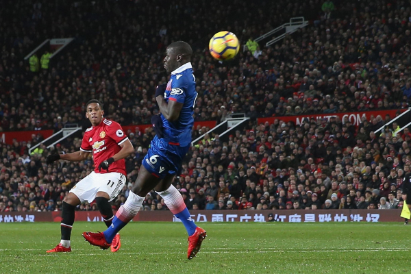 Manchester United 3 Stoke City 0: Anthony Martial scores to cut Premier League title gap on Manchester City