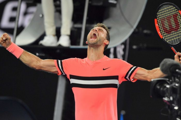 Dimitrov scrapes into Open third round after surviving five-set classic