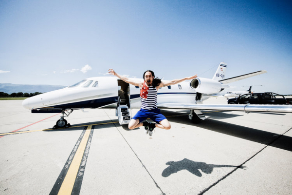Watch Steve Aoki swim with sharks, sprint the Great Wall of China, & more on the season two premiere of Aoki's World