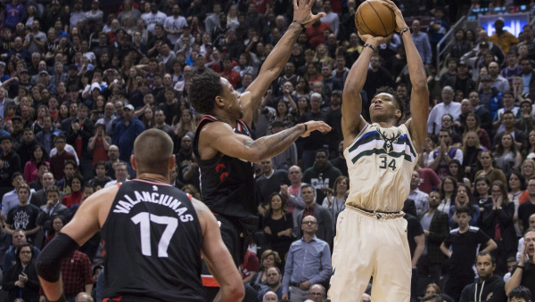 Giannis Antetokounmpo scores 26, Bucks beat Raptors 122-119 in OT