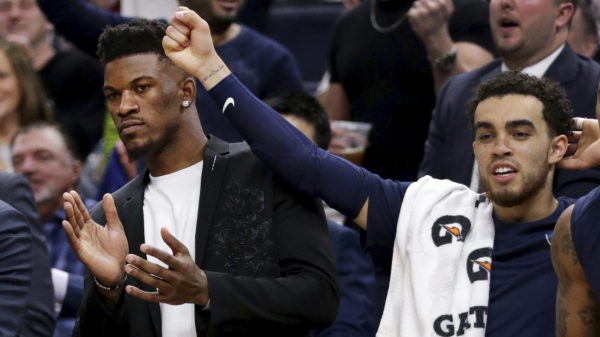 Rumor: Injured Jimmy Butler wore his jersey under shirt and jacket on Timberwolves bench