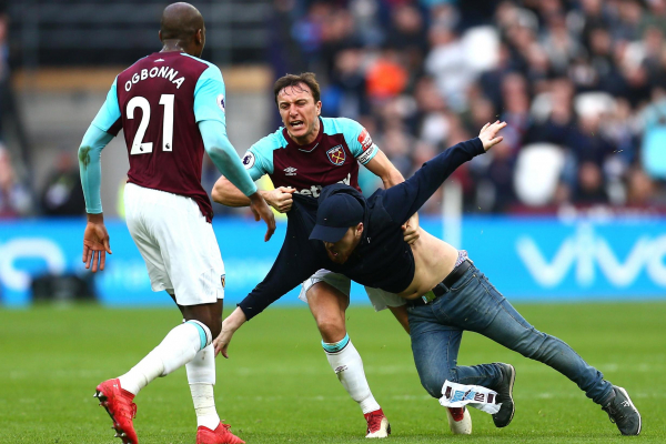 West Ham issue lifetime bans to fans who invaded London Stadium pitch and threw objects at directors box