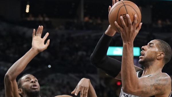 LaMarcus Aldridge's 39 points lead Spurs past Wolves, 117-101