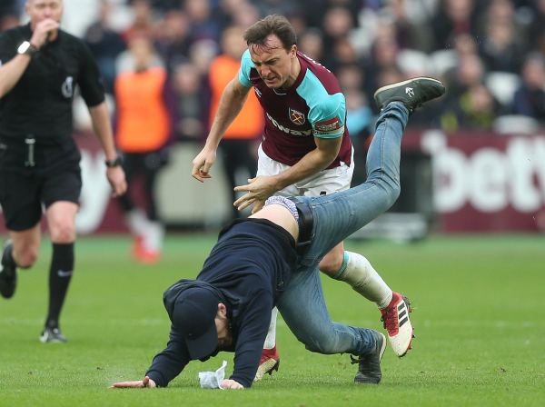 West Ham issue lifetime bans to fans who invaded pitch and threw coins against Burnley