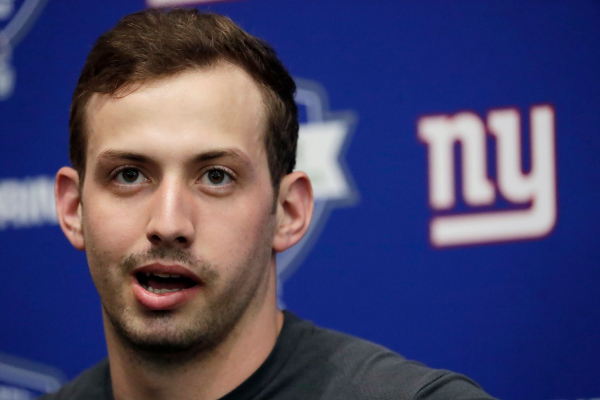 Giants Manning more concerned with new offense than draft