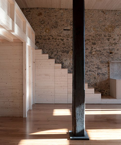 NPS arquitectos turns an early 20th-century building in portugal into a timber loft