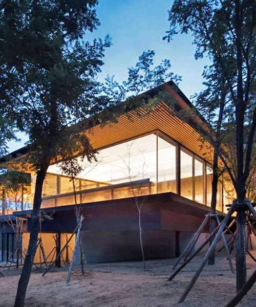 PLAT ASIA blends dining club with its nearby forest using glass walls and timber