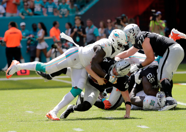 Dolphins DE Hayes to miss rest of season with torn ACL