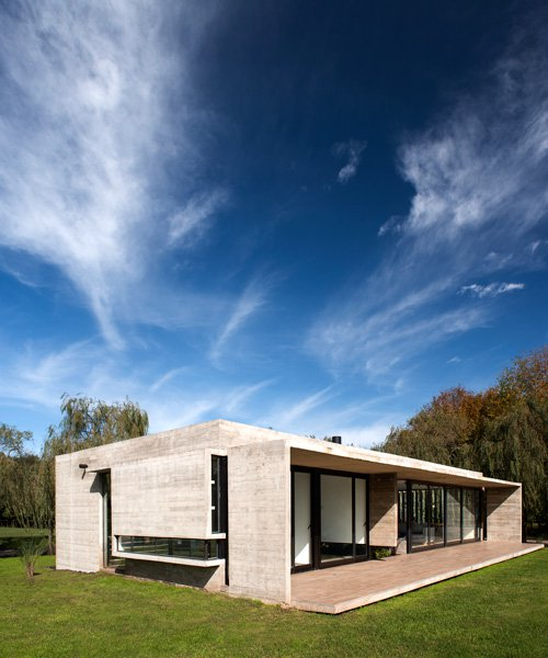 luciano kruk applies trademark concrete finish in buenos aires residence