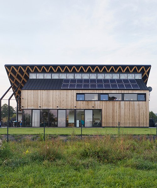 superhelix studio increases site's green space with 'house behind the roof'