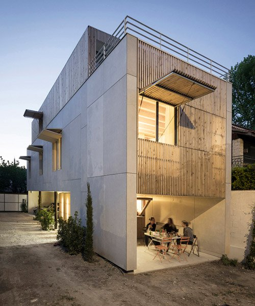 this concrete building in france by raphael azalbert is decorated with light wooden grills