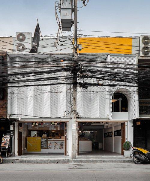 fattstudio renovates bento bar in bangkok with a perforated façade and hidden courtyard
